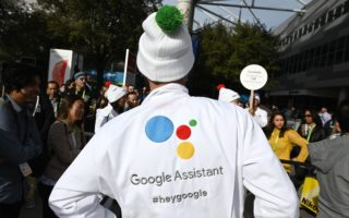 """Attendees wait to ask a question of a Google Assistant at a giant """"Hey Google"""" gumball machine game at CES 2019, January 8, 2019 at the Las Vegas Convention Center in Las Vegas, Nevada. - Google Assistant is an artificial intelligence-powered virtual assistant which can engage in two-way conversations. (Photo by Robyn Beck / AFP)        (Photo credit should read ROBYN BECK/AFP/Getty Images)"""