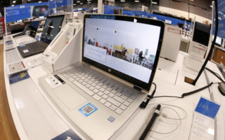 This Thursday, Feb. 22, 2018 photo shows a display of Hewlett-Packard laptop computers in a Best Buy store in Pittsburgh. (AP Photo/Gene J. Puskar)