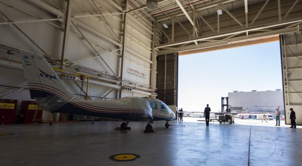NASA's X-57 Maxwell, the agency's first all-electric X-plane and first crewed X-planed in two decades, is delivered to NASA's Armstrong Flight Research Center in Edwards, California in its Mod II configuration. The first of three primary modifications for the project, Mod II involves testing of the aircraft's cruise electric propulsion system. Delivery to NASA from prime contractor Empirical Systems Aerospace of San Luis Obispo, California, marks a major milestone for the project, at which point the vehicle is reintegrated for ground tests, to be followed by taxi tests, and eventually, flight tests. X-57's goal is to further advance the design and airworthiness process for distributed electric propulsion technology for general aviation aircraft, which can provide multiple benefits to efficiency, emissions, and noise.
