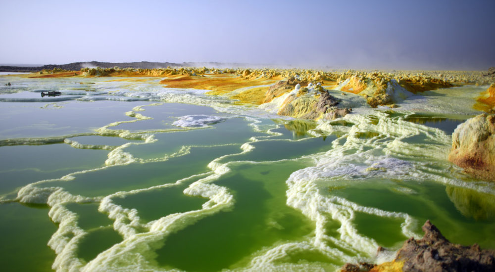 DALLOL, ETHIOPIA - JANUARY 23:  A  sulphur lake is pictured in the Danakil Depression on January 23, 2017 near Dallol, Ethiopia. The depression lies 100 metres below sea level and is one of the hottest and most inhospitable places on Earth. Despite the gruelling conditions, Ethiopians continue a centuries old industry of mining salt from the ground by hand in temperatures that average 34.5 degrees centigrade but have risen to over 50 degrees.  (Photo by Carl Court/Getty Images)