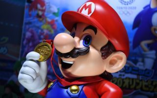 """Character of Nintendo's franchise Mario is seen at a promotional booth for the video game """"Mario & Sonic at the Olympic Games Tokyo 2020"""" during the Tokyo Game Show in Makuhari, Chiba Prefecture on September 12, 2019. (Photo by CHARLY TRIBALLEAU / AFP)        (Photo credit should read CHARLY TRIBALLEAU/AFP via Getty Images)"""