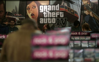A view of a store promoting the new Grand Theft Auto computer game, Grand Theft Auto IV in London, Tuesday, April 29, 2008, on the day of it's worldwide release, with the exception of Japan. It is the ninth title in the Grand Theft Auto series and the first in its fourth generation. (AP Photo/Nathan Strange)
